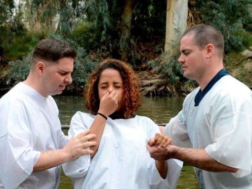 Wesleyan chaplain baptizes 22 in Jordan River