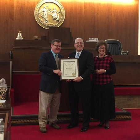Former district superintendent honored by governor
